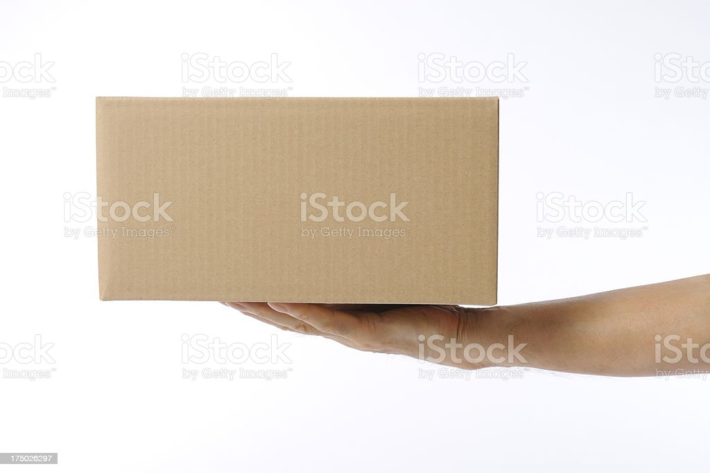 Isolated shot of delivering a cardboard box on white background stock photo