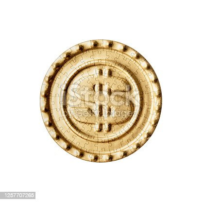 Close-up of dollar sign gold coin made with Jigsaw puzzle on white background.
