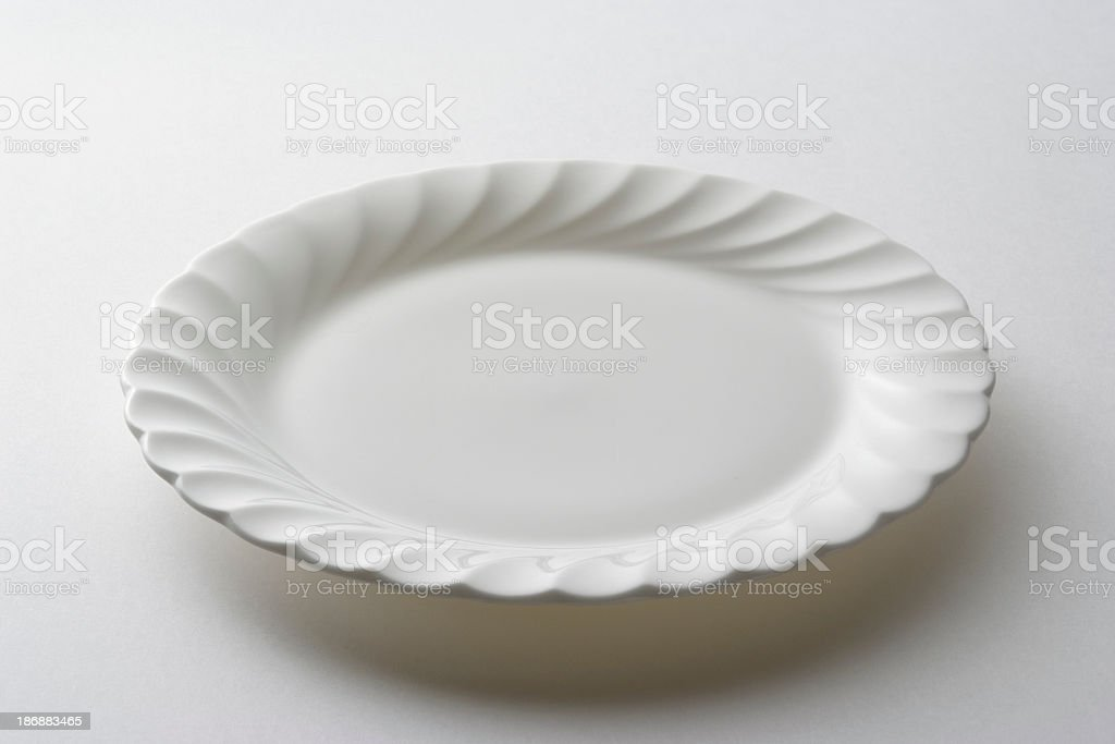 Isolated shot of empty white plate on white background royalty-free stock photo