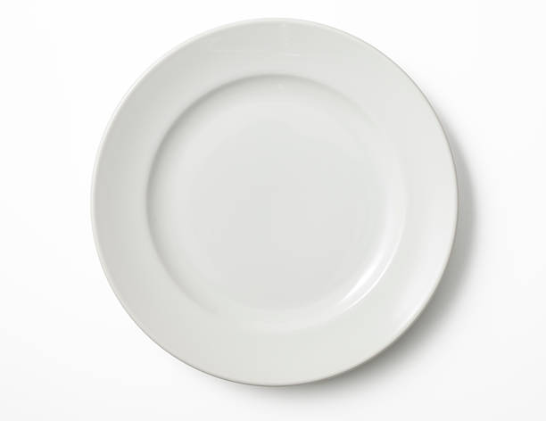 isolated shot of empty white plate on white background - plate stock pictures, royalty-free photos & images