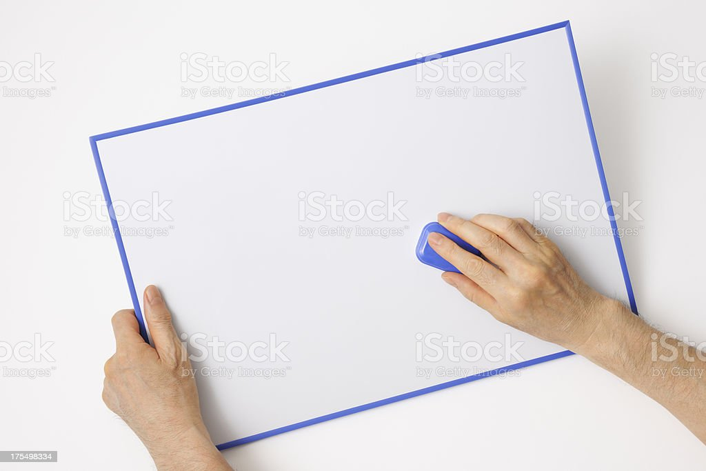 Isolated shot of erasing a whiteboard on white background stock photo