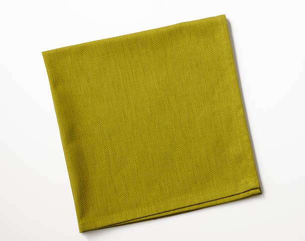 isolated shot of folded green napkin on white background - servett bildbanksfoton och bilder