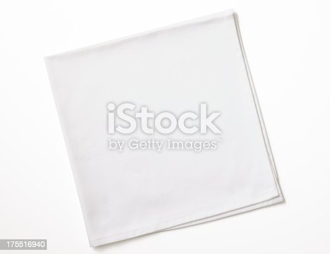 Folded white napkin isolated on white background with clipping path.