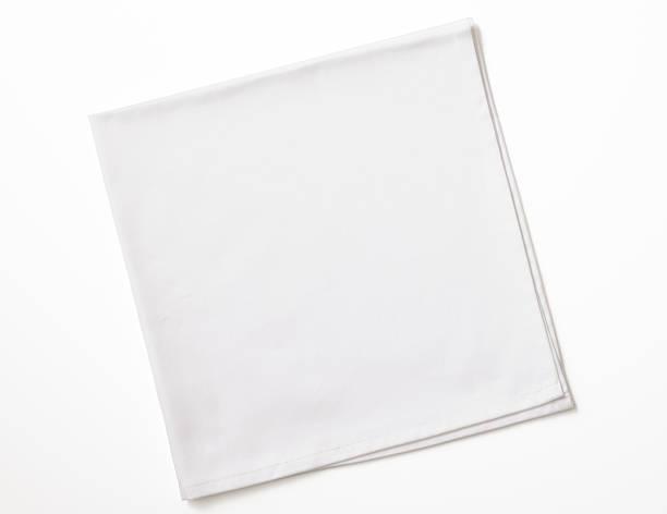 isolated shot of folded white napkin on white background - servett bildbanksfoton och bilder