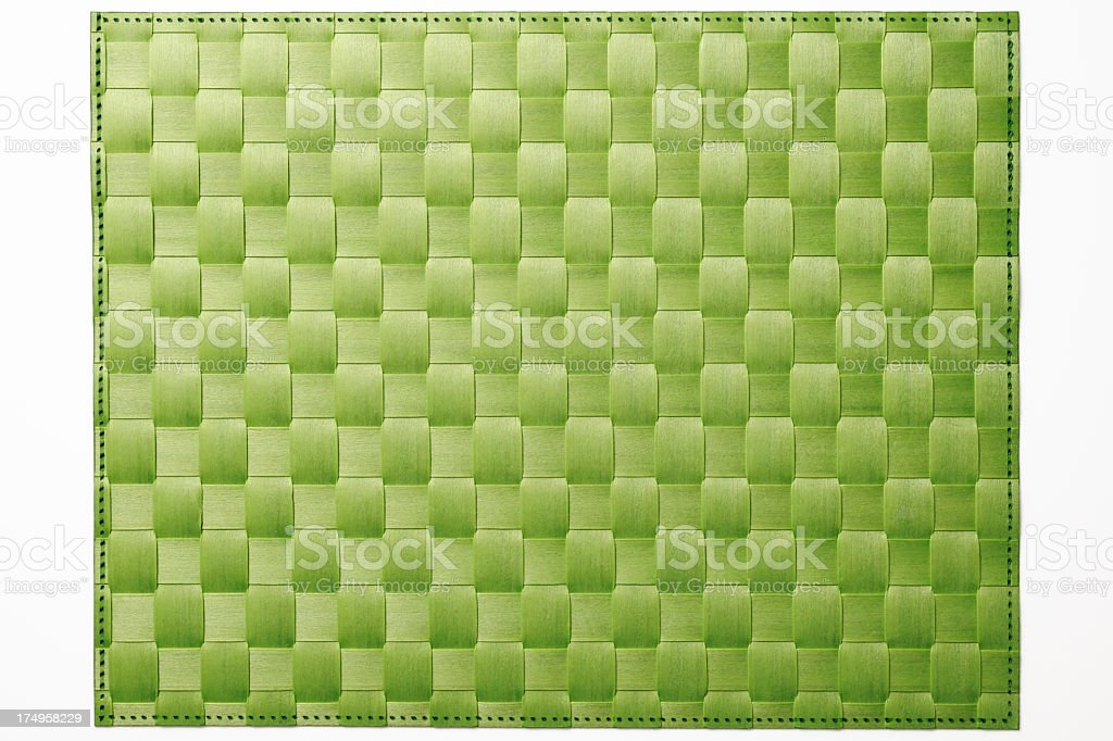 Isolated shot of green bamboo place mat on white background stock photo
