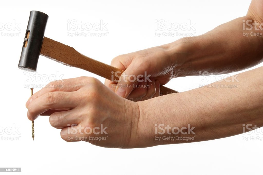 Isolated shot of hammering against white background royalty-free stock photo