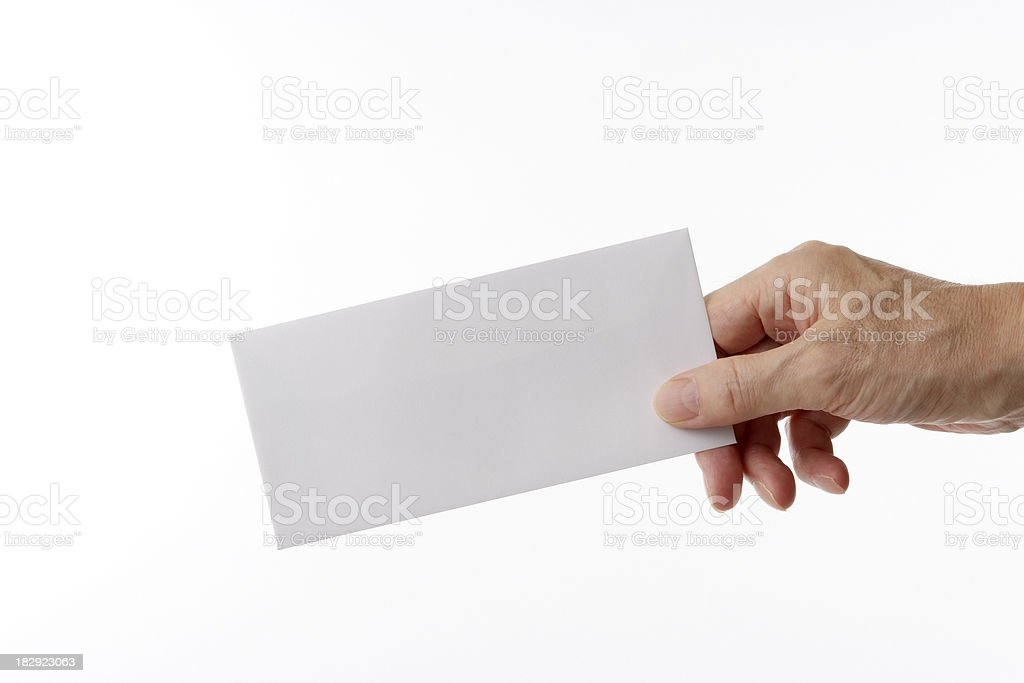 Isolated shot of holding a blank envelope against white background royalty-free stock photo