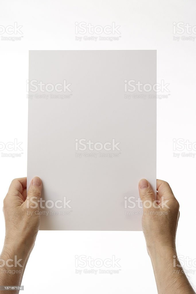 Isolated shot of holding a blank paper against white background royalty-free stock photo