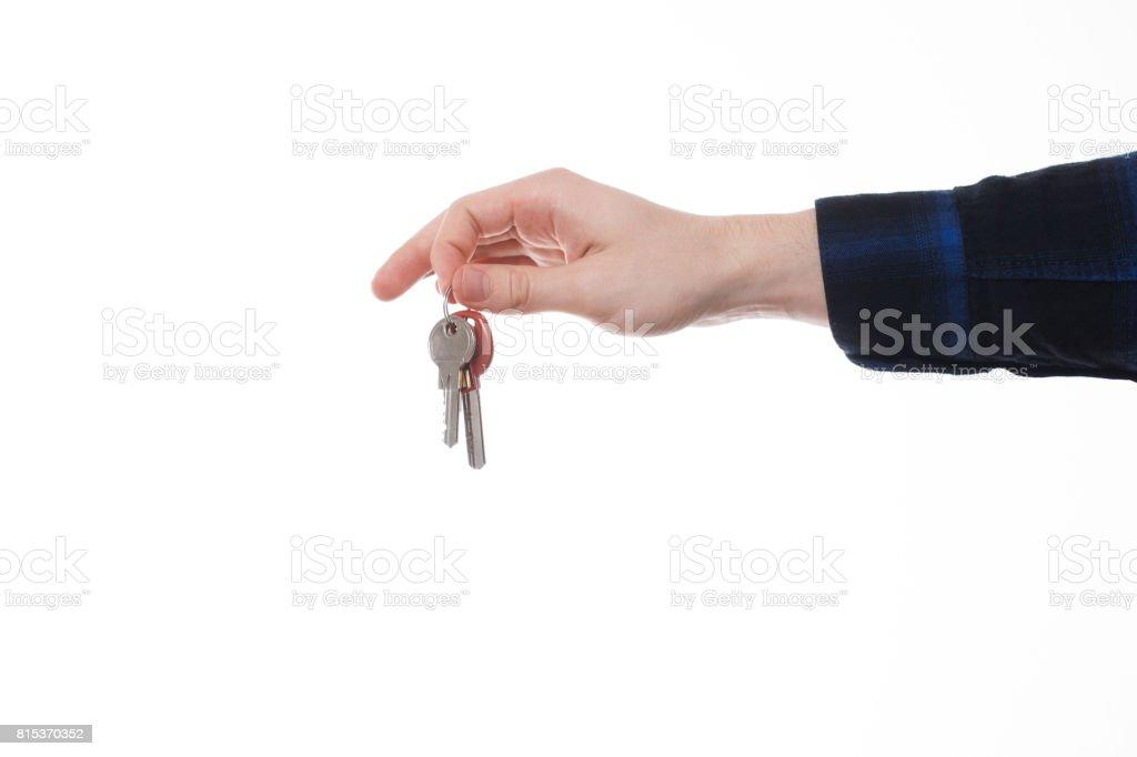 Isolated shot of holding a house keys on white background stock photo