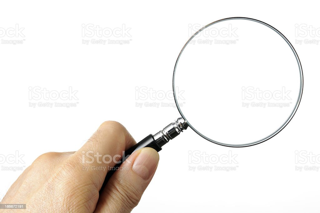 Isolated shot of holding a magnifying glass on white background royalty-free stock photo
