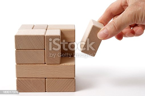 657779378 istock photo Isolated shot of holding a wood block on white background 183017376