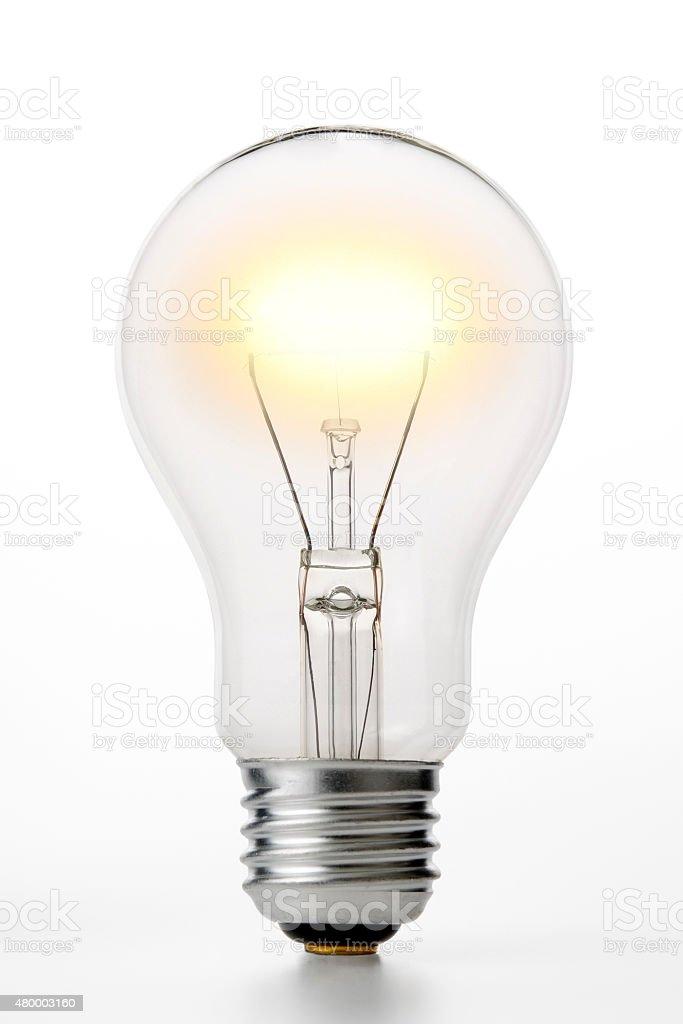 Lovely Isolated Shot Of Illuminated Light Bulb On White Background Stock Photo