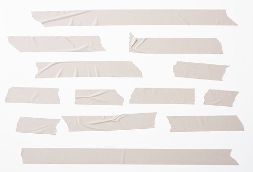 Lots of torn masking tape, isolated on white with clipping path.