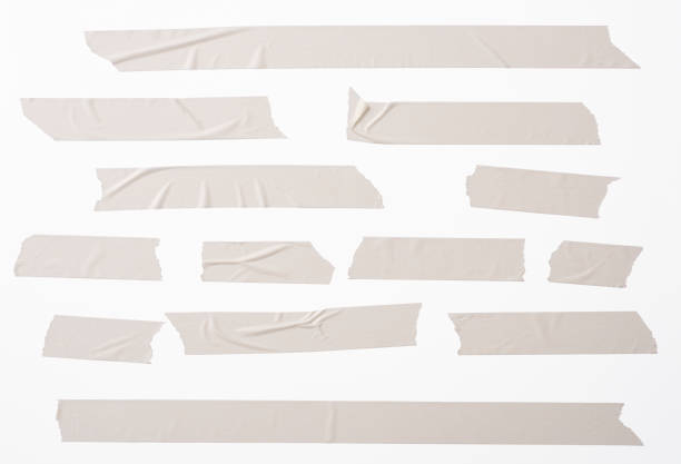 Isolated shot of many torn masking tape on white background stock photo