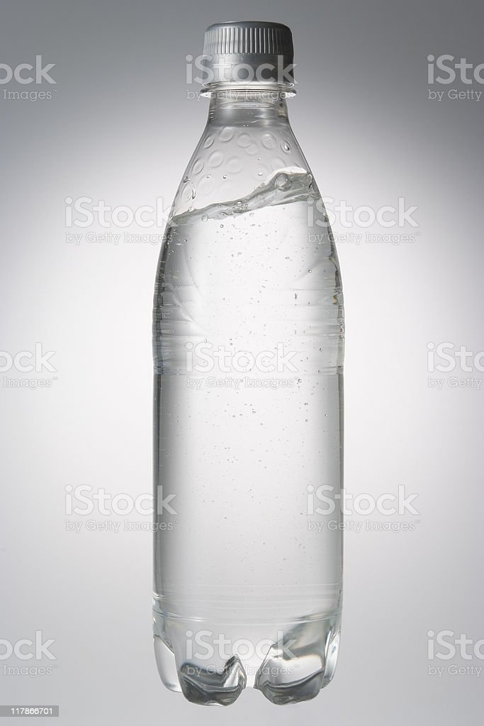 Isolated shot of motion of bottle's water on white background royalty-free stock photo