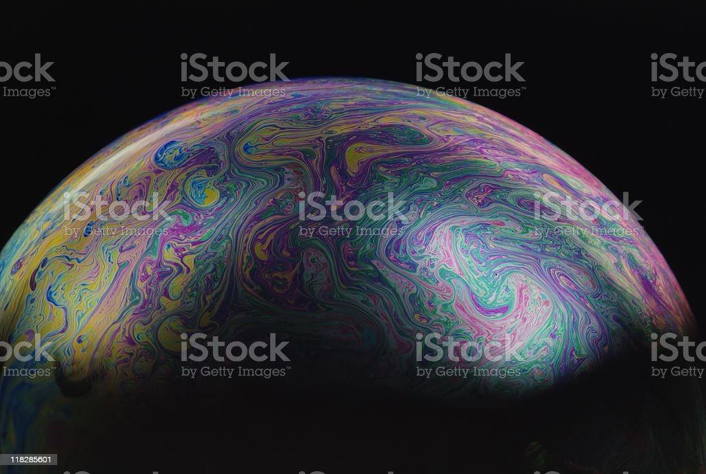 Isolated shot of multicolored soap bubble on black background royalty-free stock photo