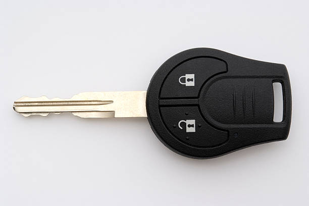 Isolated shot of new car key on white background Close-up shot of new car key isolated on white background.  car key stock pictures, royalty-free photos & images