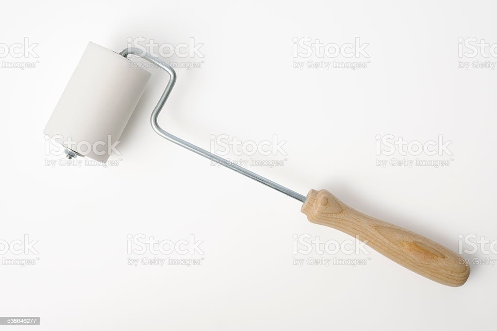 Isolated shot of new paint roller on white background stock photo
