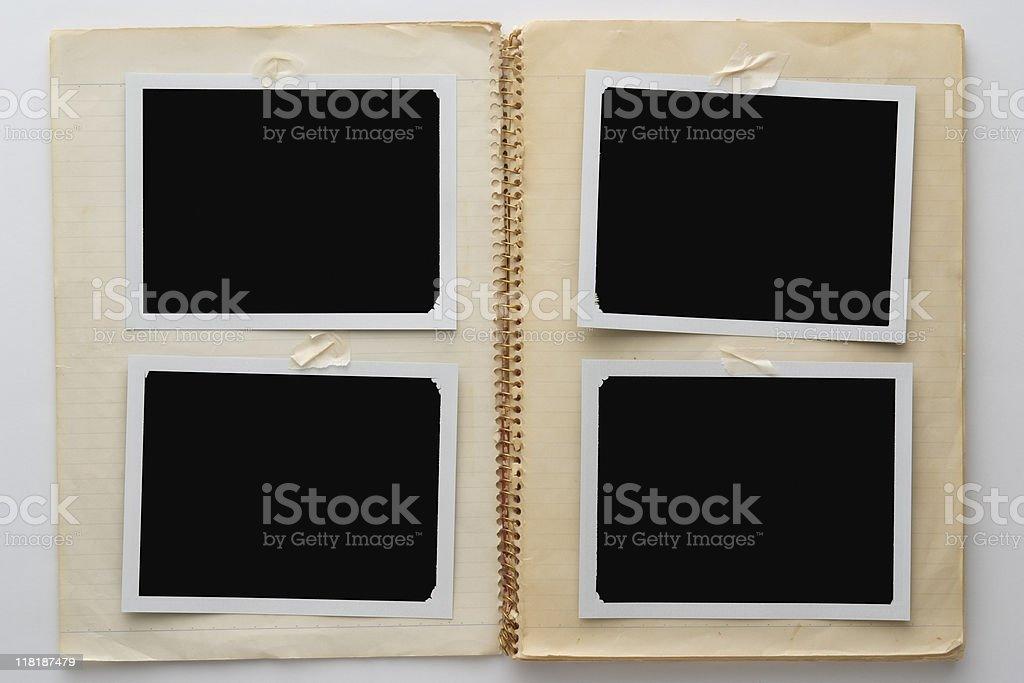 Isolated shot of old notebook blank Polaroid on white background royalty-free stock photo