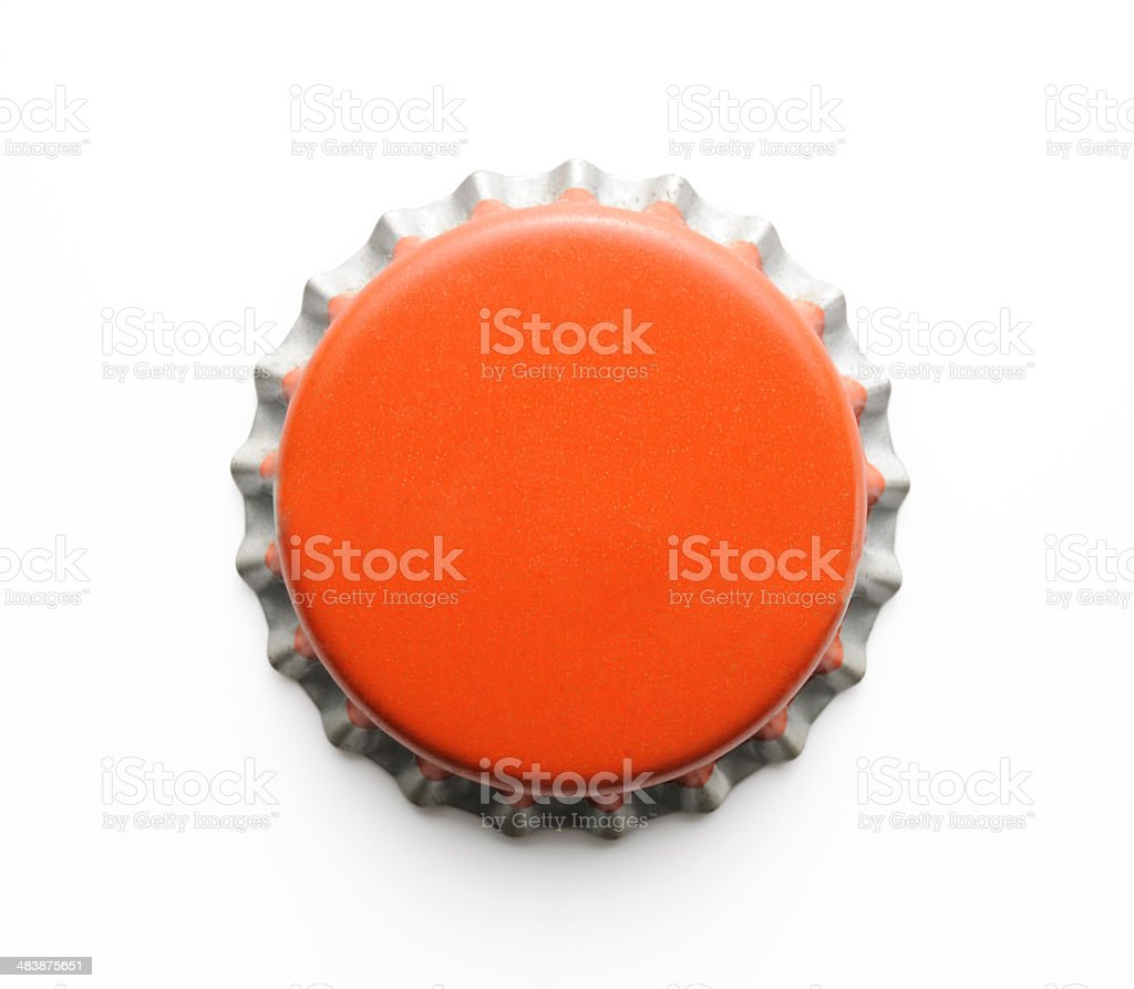 Isolated shot of old red metal bottle cap on white stock photo