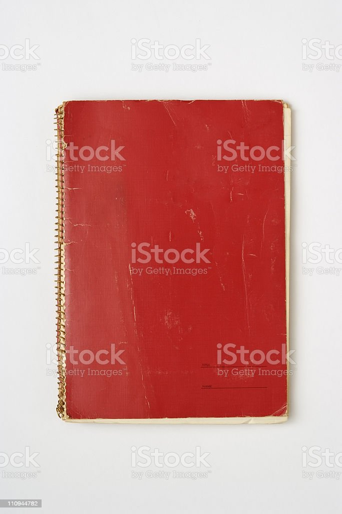 Isolated shot of old red spiral notebook on white background stock photo