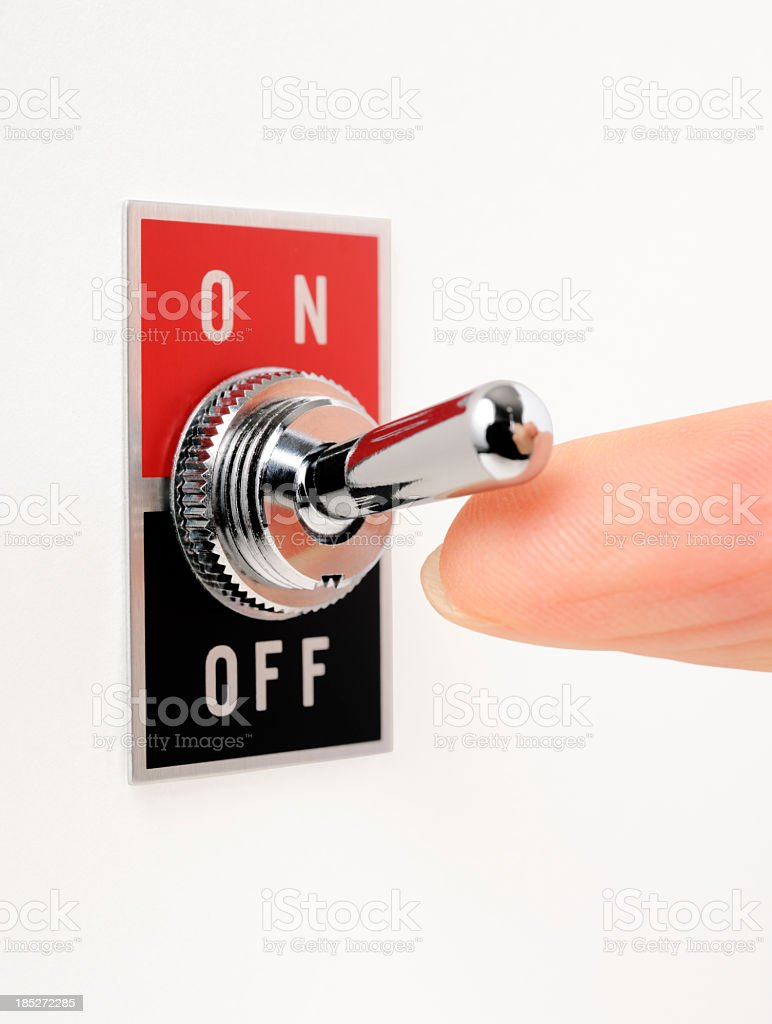 Isolated shot of ON/OFF switch with finger on white background stock photo