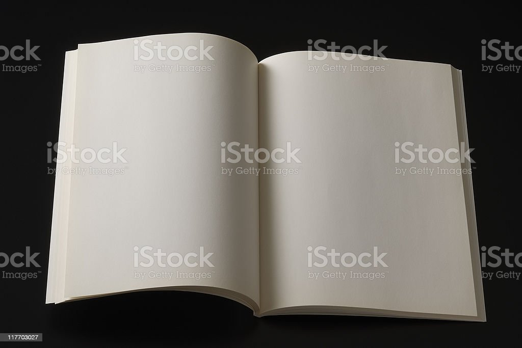 Isolated shot of opened blank book on black background royalty-free stock photo