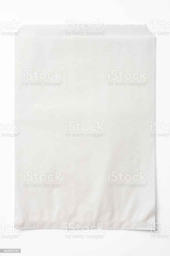 Isolated shot of opened blank paper bag on white background stock photo