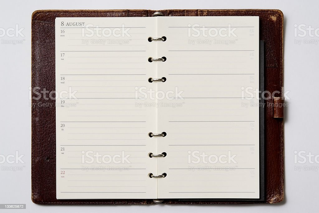 Isolated shot of opened blank personal organizer on white background stock photo