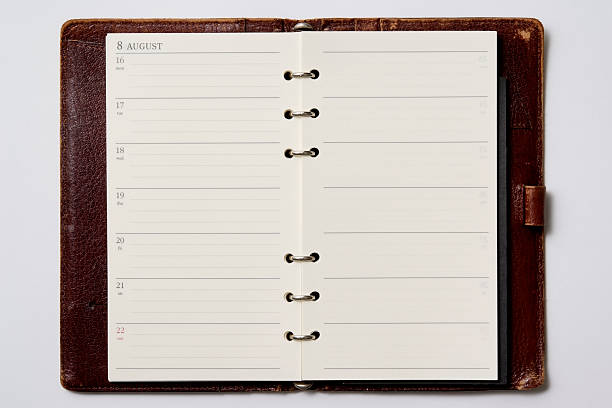isolated shot of opened blank personal organizer on white background - page stock photos and pictures