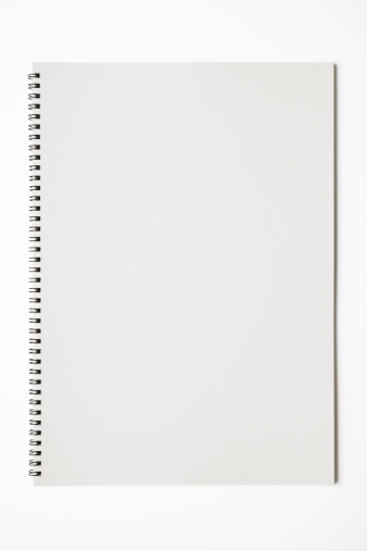 Opened blank spiral sketchbook isolated on white background with clipping path.