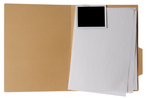 Opened brown file folder, stacked blank documents with blank photo attached isolated on white background with Clipping path.