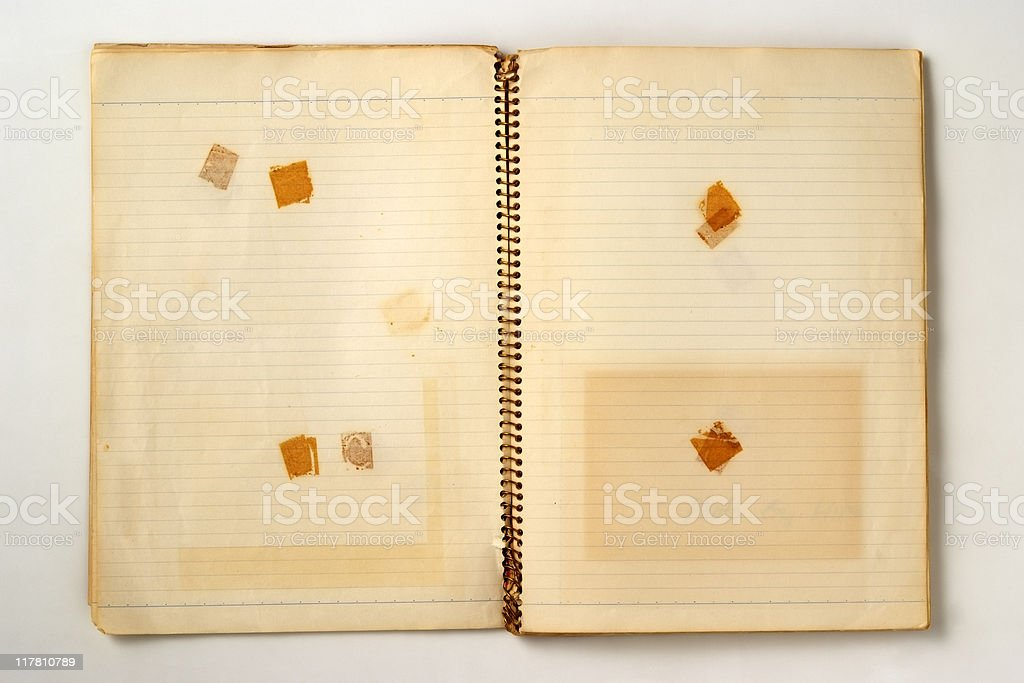 Isolated shot of opened old spiral notebook on white background royalty-free stock photo