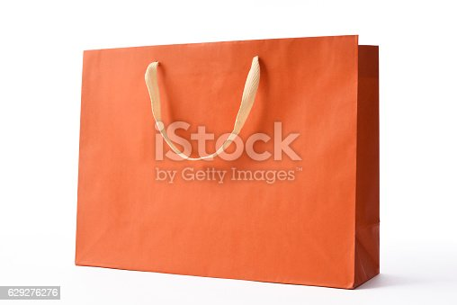 Orange color shopping bag isolated on white background with clipping path.