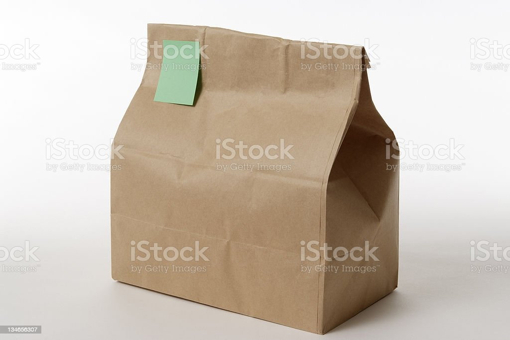 Isolated shot of packed lunch with note on white background royalty-free stock photo
