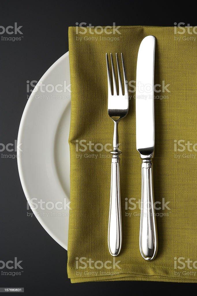 Isolated shot of place setting on black background royalty-free stock photo