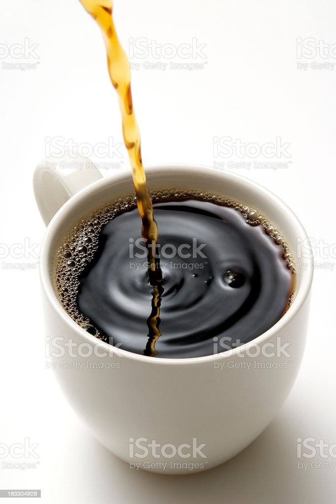 Isolated shot of pouring a fresh coffee on white background stock photo