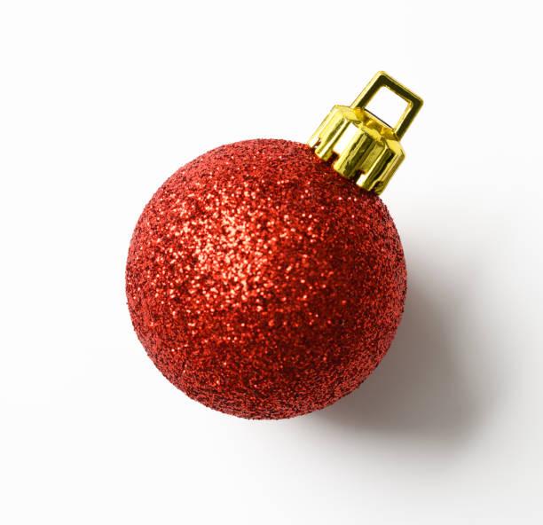 isolated shot of red christmas ball on white background - bombka zdjęcia i obrazy z banku zdjęć