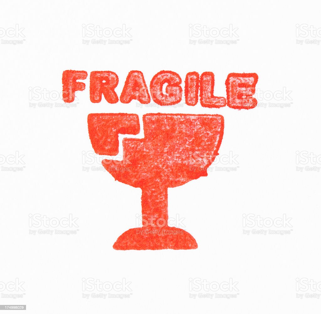Isolated shot of red FRAGILE rubber stamp on white background royalty-free stock photo