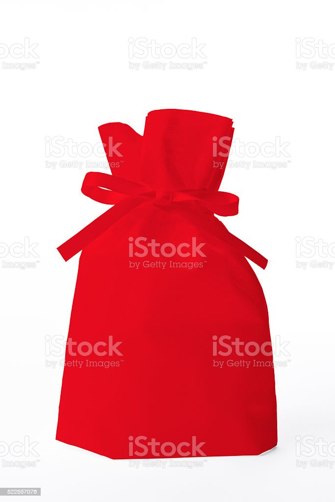 Isolated shot of red organdy gift bag on white background stock photo