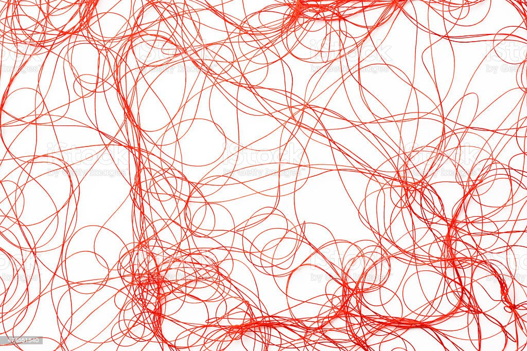 Isolated shot of red silk thread on white background stock photo