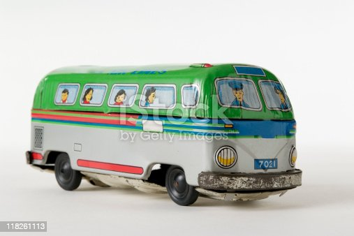 Old tin toy air lines bus isolated on white background.