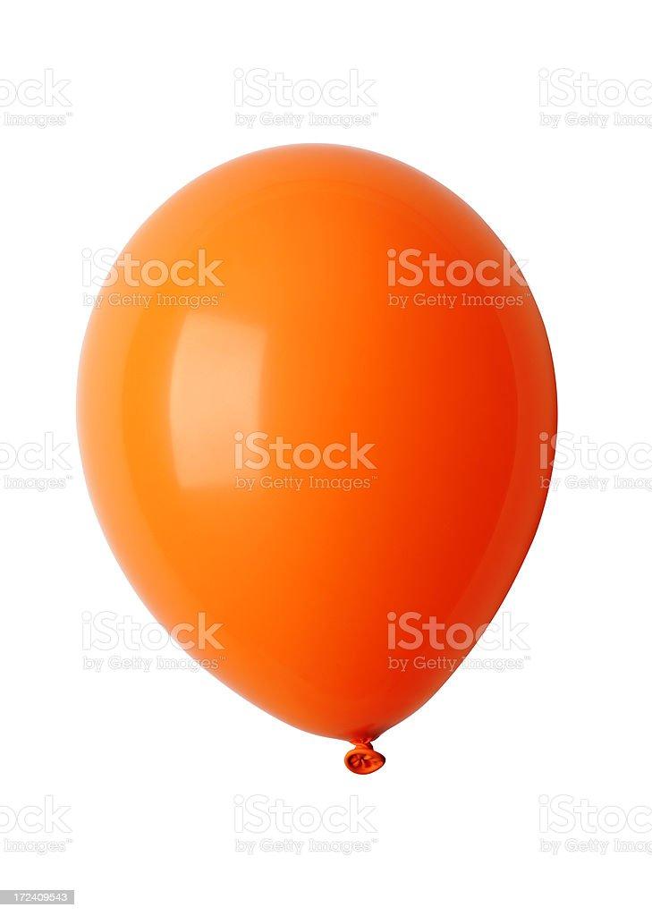 Isolated shot of shiny orange balloon against white background royalty-free stock photo