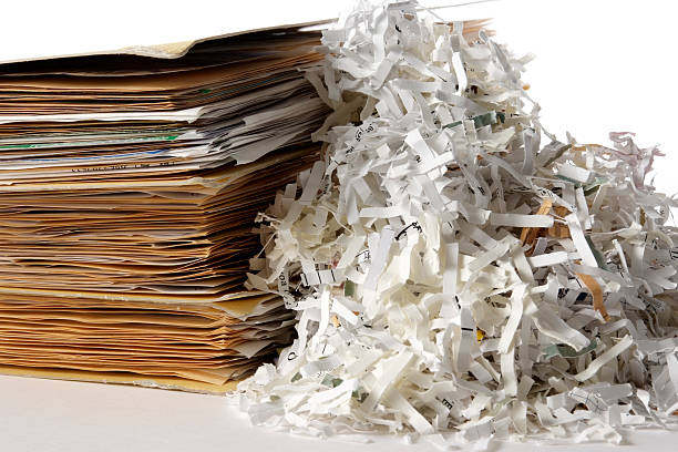 isolated shot of shredded documents with folder on white background - shredded paper stock photos and pictures