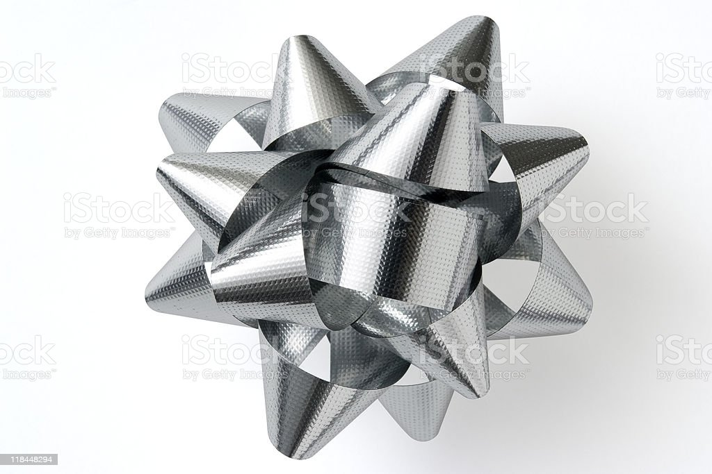 Isolated shot of silver Christmas bow on white background royalty-free stock photo