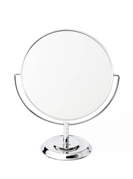 Isolated shot of silver make-up mirror on white background. stock photo