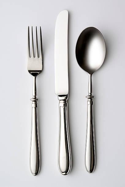 Isolated shot of silverware on white background stock photo