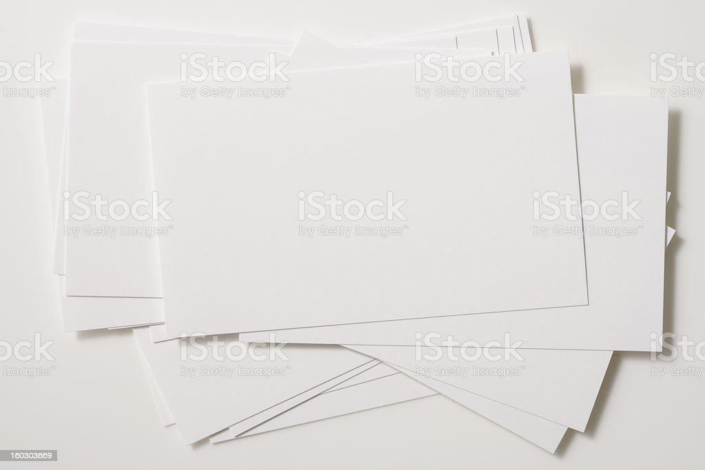 Isolated shot of stacked blank business cards on white background royalty-free stock photo