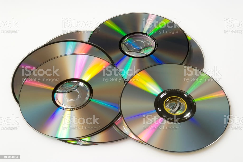 Isolated shot of stacked compact discs on white background stock photo