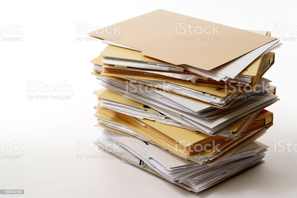 Isolated shot of stacked file folders on white background stock photo